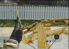 File:Reloading Gold Crossbow.JPG