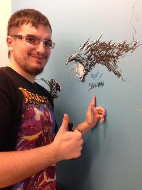 Sergej signs the wall