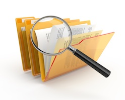 File:Magnifying glass over folders.jpg