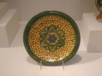 Earthenware dish with sancai glaze and rosette medallion, Tang Dynasty