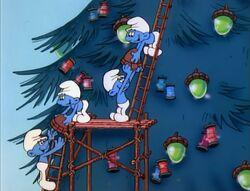 The Smurfs decorating their Christmas tree