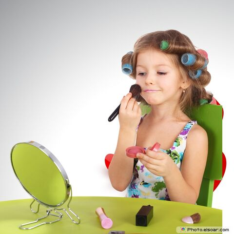 File:Glamour-Girl-With-Cosmetics-In-front-of-the-mirror-1-.jpg