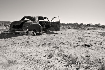 File:3228803-black-and-white-image-of-an-old-rusty-car-in-the-desert.jpg