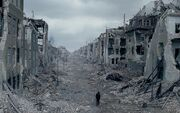 Man-walking-through-destroyed-city