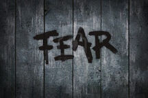 9501723-the-word-fear-on-old-wooden-planks--illustration