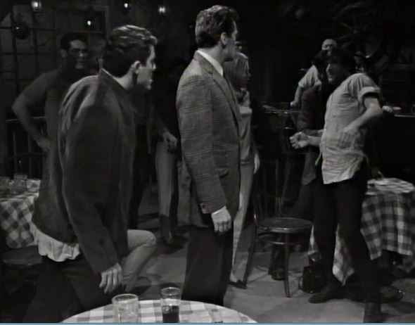 File:Burke breaks up the fight ep2.jpg