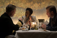Amanda Waller sits at dinner with government officials