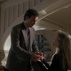 Bruce holds Vicki's hands.
