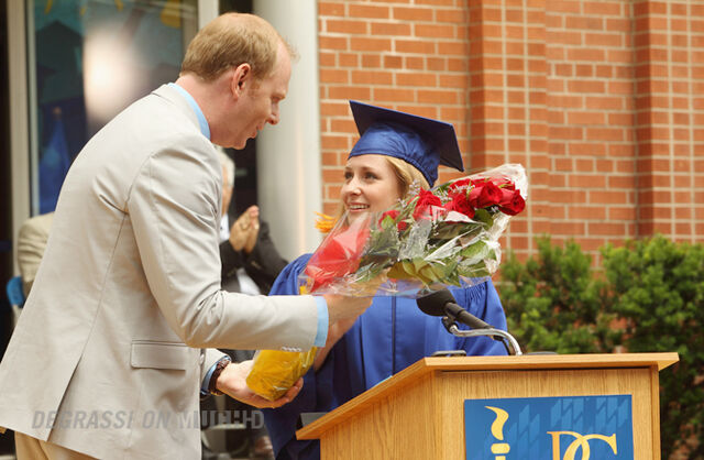 File:Mr. Simpson hands Holly J. flowers at graduation.jpg
