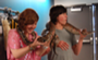 File:90x55x2-Munro and Aislinn behind the scenes.png