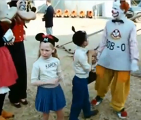 Disney characters with clown and mouseketeers