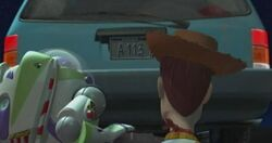 Woody and Buzz Lightyear watch the van