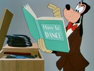 Goofy reading a How to Dance book