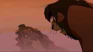 Kovu sees Scar's Face in water