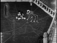 Mickey with skeleton on a cobweb
