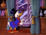 Scrooge admiring his pearl