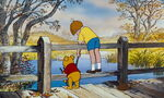 Christopher Robin and Pooh Bear are both on a bridge