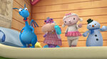 Four toy characters dancing