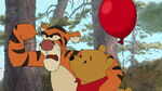 Tigger is telling Pooh Bear The Hundred Acre Wood needs a hero