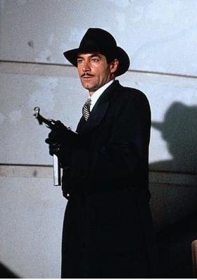 File:Neville Sinclair with a Gun.jpg