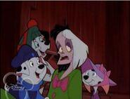Dogs and Cruella in costume