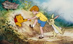 Rabbit and Christopher Robin must pull Pooh Bear out