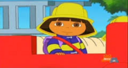 Dora sitting on rojo