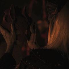 Saarebas holding the incomplete mask