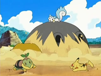 Archivo:EP534 Hippowdon emergiendo de la arena.png