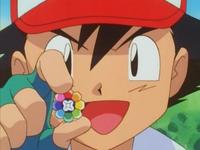 Archivo:EP026 Ash con la medalla Arcoiris.png