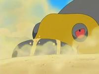 Archivo:EP534 Hippowdon emergiendo de la arena (2).png