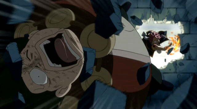 File:Natsu beats Karcka after he tries to kill his guildmate.jpg