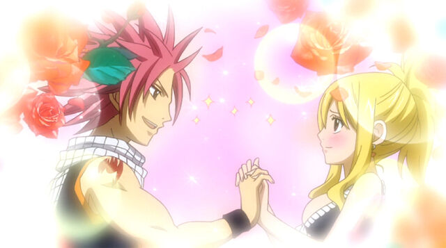 File:Natsu holds Lucy's hands.jpg