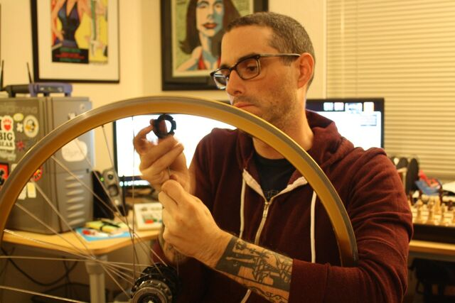 File:Josh Sawyer removing spokes from a bicycle wheel.jpg