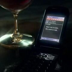 Vincent's cellphone in <i>Dirge of Cerberus</i>.
