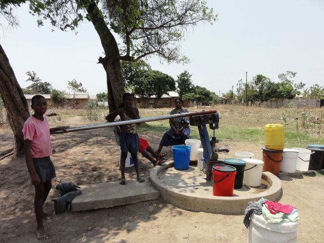 File:Women and children at a borehole.jpg