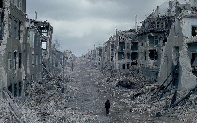 File:Man-walking-through-destroyed-city.jpg