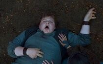 Young hodor seizing hold the door