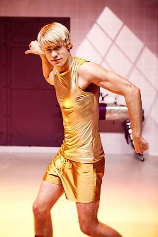 File:Sam in gold shorts.jpg