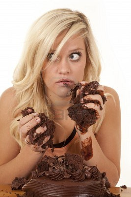 File:12104638-a-woman-chocolate-cake-all-over-her-face-and-hands-with-a-shocked-expression-on-her-face.jpg