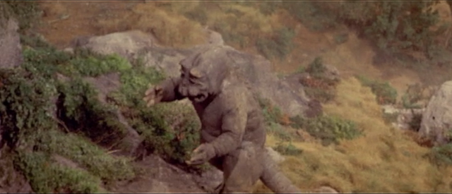 File:All Monsters Attack - Minilla walks up to Ichiro.png