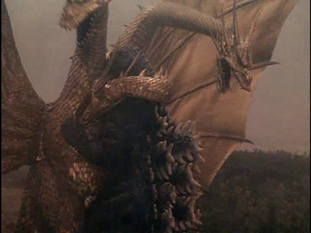 File:GvsKG-King Ghidorah coiling Godzilla.png