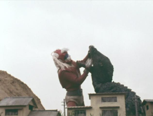 File:Go! Godman - Episode 6 Godman vs. Gorosaurus - 28 - Apparently Gorosaurus has no bones in his neck.png