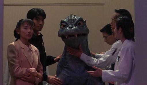 File:Baby Godzilla with human friends.jpg