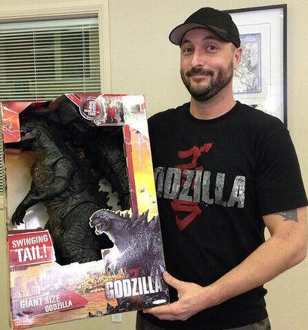 File:Chris Mowry With Giant Size Godzilla Figure.jpg