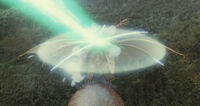 Grand King Ghidorah's force barrier repelling Mothra's Mineral Chest Beam