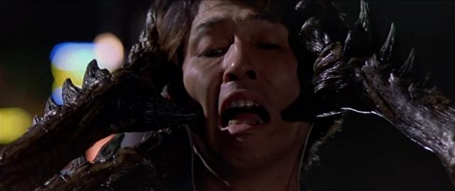 File:Godzilla vs. Megaguirus - Meganulon holds her prey.png