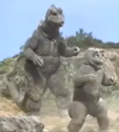 File:All Monsters Attack 7 - Godzilla forces Minilla to fight.png