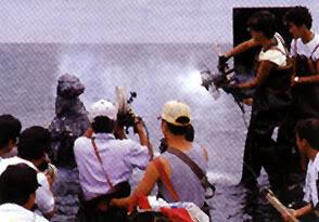 File:Godzilla gets sprayed by Mothra silk machine.jpg