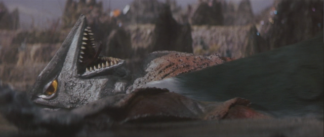 File:Gamera - 5 - vs Guiron - 17 - Guiron Cuts Space Gyaos' OTHER Wing.png